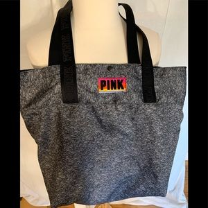 Pink brand tote bag with logo handles